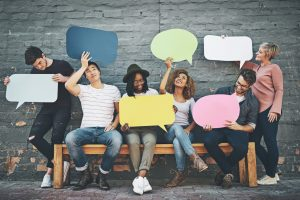 group holding speech bubbles